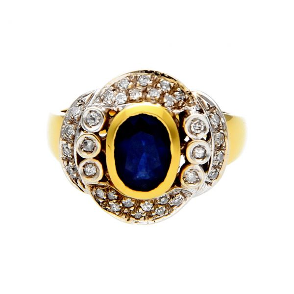 Antique white and yellow gold ring with sapphire and diamonds