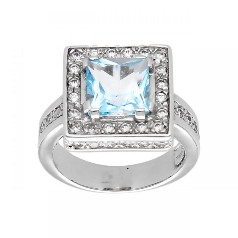 White gold ring with topaz and zircon