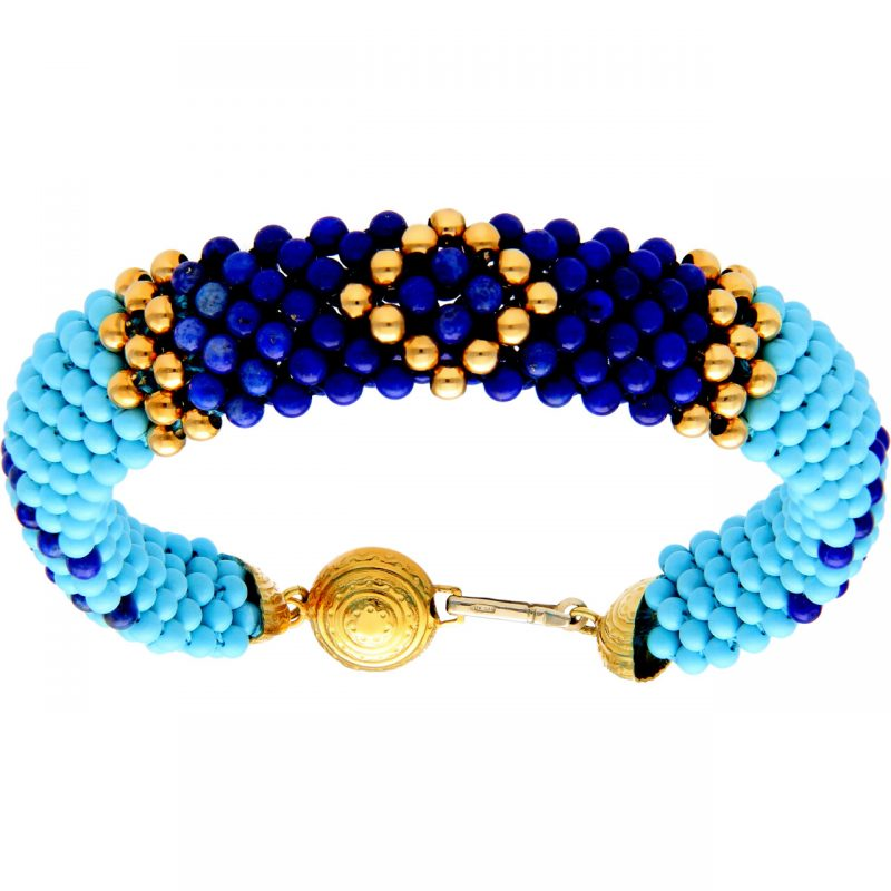Ethnic bracelet with yellow gold clasp