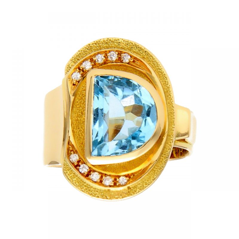 Anello in oro giallo con Topazio Azzurro e Diamanti
